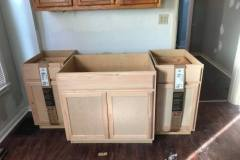 Kitchen renovation in progress - new cabinets ready to install