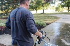 Power washing the driveway