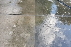 Power washing the driveway - before on the right, after on the left
